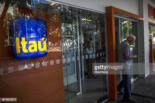A customer exits an Itau Unibanco SA bank branch in Rio de Janeiro Brazil on Monday July 31 2017 Itau Unibanco SA is scheduled to release earnings...