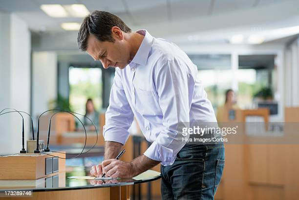 Customer filling in bank statement