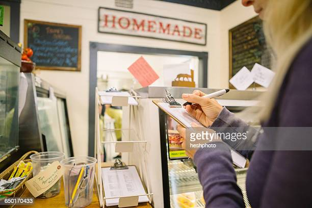 customer filling order form in general store, hague, usa - heshphoto stock pictures, royalty-free photos & images