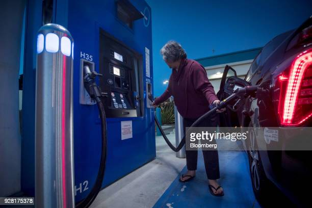 A customer fills a car with hydrogen at a TrueZero fueling station in Mill Valley California US on Friday Feb 23 2018 California is spending more...