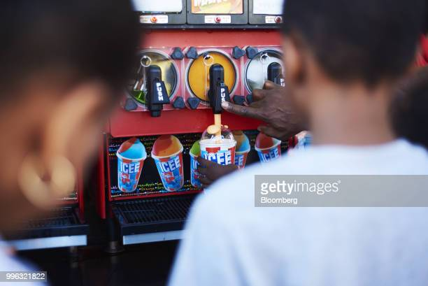 A customer fills a cup with an Icee slushie drink at Luna Park in Coney Island in the Brooklyn Borough of New York US on Saturday July 7 2018...
