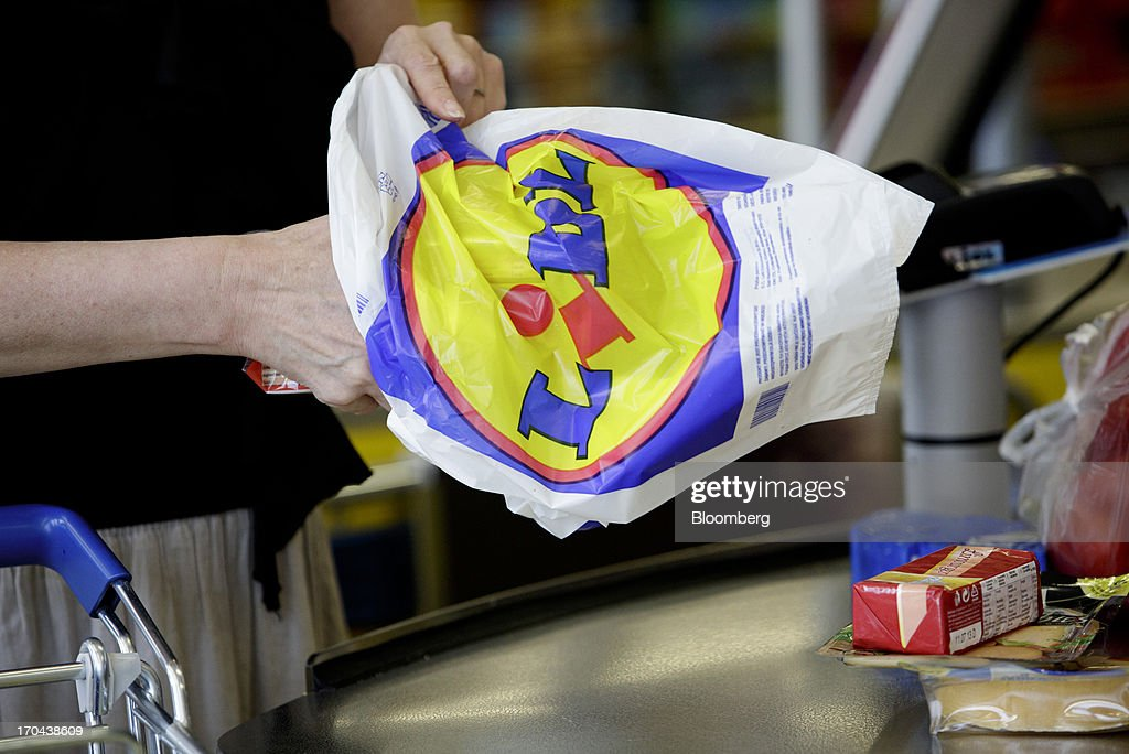 A customer fills a shopping bag at the check out counter of a Lidl discount supermarket store, operated by Schwarz Group, in Prague, Czech Republic, on Thursday, June 13, 2013. Ahold and Tesco are tied as the Czech Republic's third-largest grocer by revenue behind Lidl discount store owner Schwarz Group and Rewe AV, which owns the Billa supermarkets, according to Krakow, Poland-based market researcher PMR. Photographer: Martin Divisek/Bloomberg via Getty Images