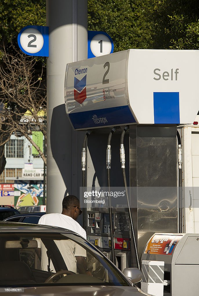 A customer fills a vehicle with gasoline at a Chevron Corp. station in San Francisco, California, U.S., on Friday, Feb. 1, 2013. Chevron Corp., the second-largest U.S. energy company, said fourth-quarter profit increased 41 percent to a record $7.25 billion as it reported stronger refining results and a gain from an Australian natural gas field swap. Photographer: David Paul Morris/Bloomberg via Getty Images