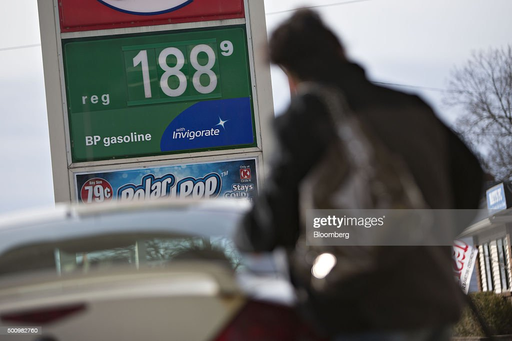 A customer fills her vehicle with fuel at a gas station in Chillicothe, Illinois, U.S., on Friday, Dec. 11, 2015. The cost of a gallon of regular gasoline fell 6.7 percent last month, based on data from motoring group AAA. Photographer: Daniel Acker/Bloomberg via Getty Images
