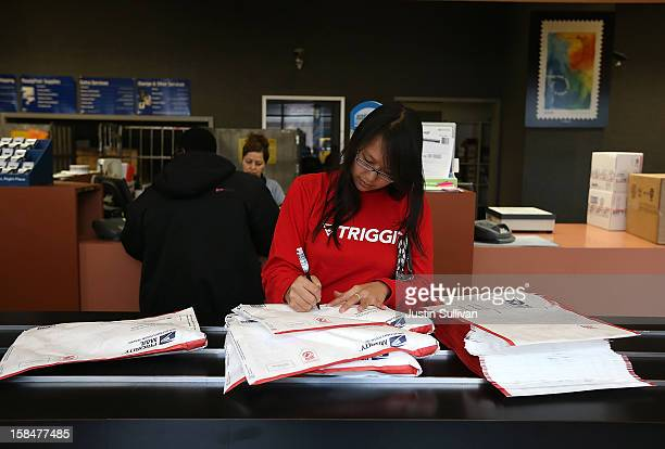 A customer fills in address information on packages at United States Post Office at Rincon Center on December 17 2012 in San Francisco California...