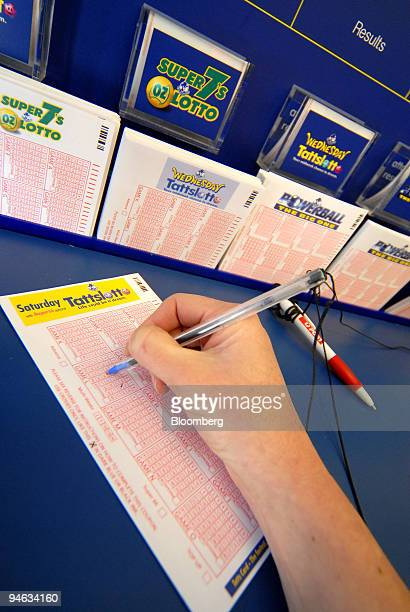 A customer fills out a Tattersall's Ltd lottery ticket at a newspaper shop in Melbourne Australia on Friday Aug 24 2007 Tattersall's will post...