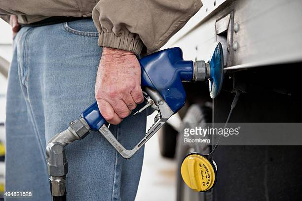 A customer fills up a vehicle with fuel at an Exxon Mobil Corp gas station in Rockford Illinois US on Wednesday Oct 28 2015 Exxon Mobil Corp is...