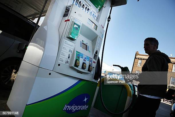 A customer fills up his car at a BP gas station in Brooklyn on February 2 2016 in New York City The oil industry giant reported on Tuesday a $33...