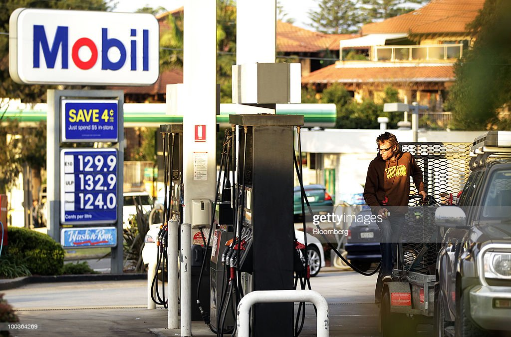 A customer fills up his car with fuel at an Exxon Mobil Corp. gas station in Sydney, Australia, on Monday, May 24, 2010. 7-Eleven Australia is close to acquiring most of Exxon Mobil Corp's local filling stations, the Australian newspaper reported on its website on May 19, without saying where it got the information. Photographer: Ian Waldie/Bloomberg via Getty Images