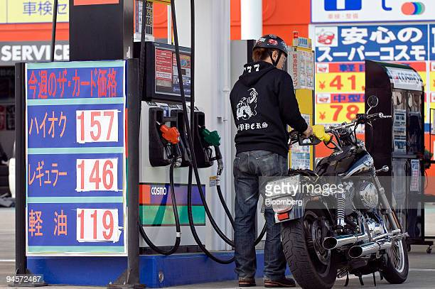 A customer fills up his motorbike at a Cosmo Oil Co gas station in Tokyo Japan on Monday Nov 5 2007 Cosmo Oil Co rose to the highest in two weeks in...