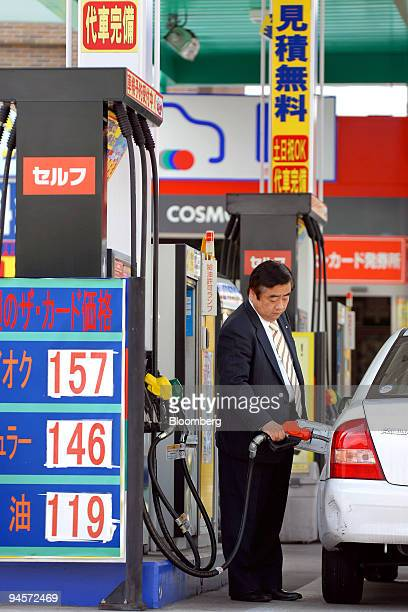 A customer fills up his vehicle at a Cosmo Oil Co gas station in Tokyo Japan on Monday Nov 5 2007 Cosmo Oil Co rose to the highest in two weeks in...