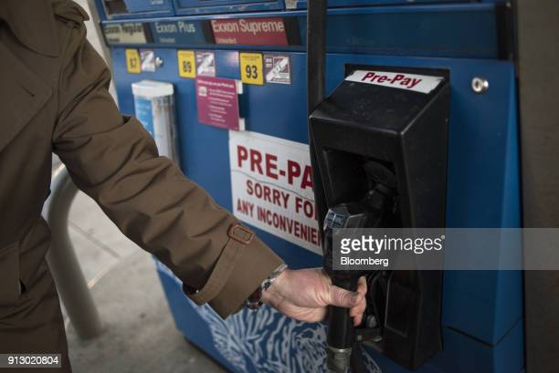 A customer finishes pumping fuel at an Exxon Mobil Corp gas station in Nashport Ohio US on Friday Jan 26 2018 Exxon Mobil Corp is scheduled to...