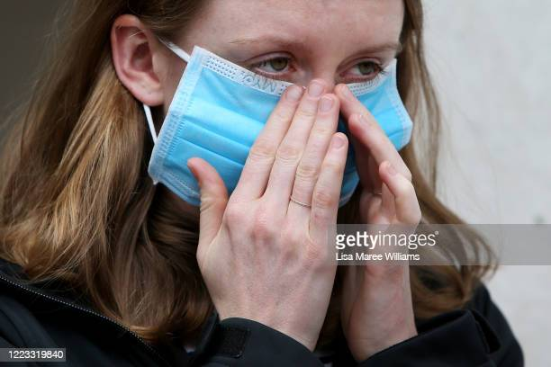 Customer fits a face mask prior to entering the Apple Store at Bondi Junction on May 07, 2020 in Sydney, Australia. Apple stores across Australia...
