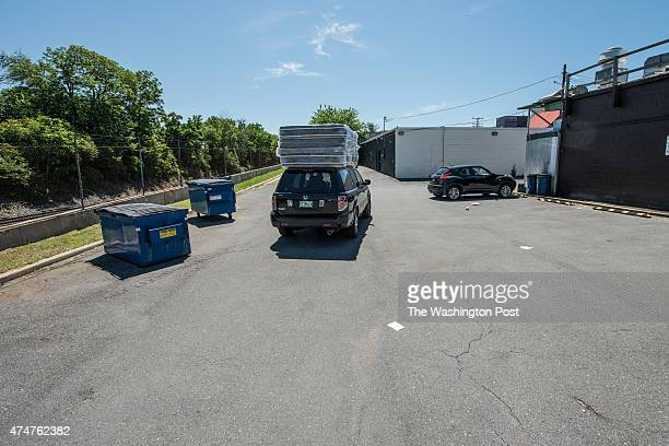 Customer Freddie Cataneda drives away after purchasing mattresses from Mattress Fame on May 23 2015 in Rockville MD On the mattressiest of all...