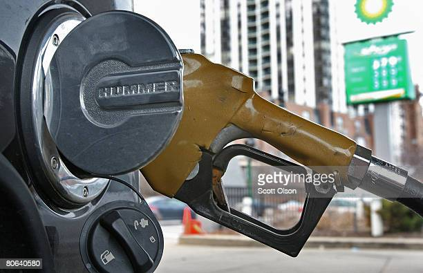 A customer gets gas for a Hummer SUV at a fullservice pump at a BP gas station April 11 2008 in Chicago Illinois Full service regular gas is $459 a...