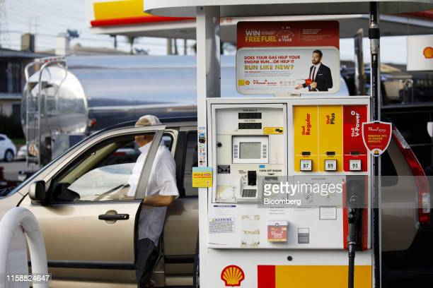 A customer gets in a vehicle at a Royal Dutch Shell Plc gas station in Redondo Beach California US on Sunday July 28 2019 Royal Dutch Shell is...