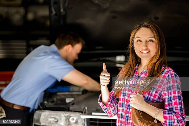 customer gives auto mechanic a happy thumbs-up for great service. - tevreden stockfoto's en -beelden