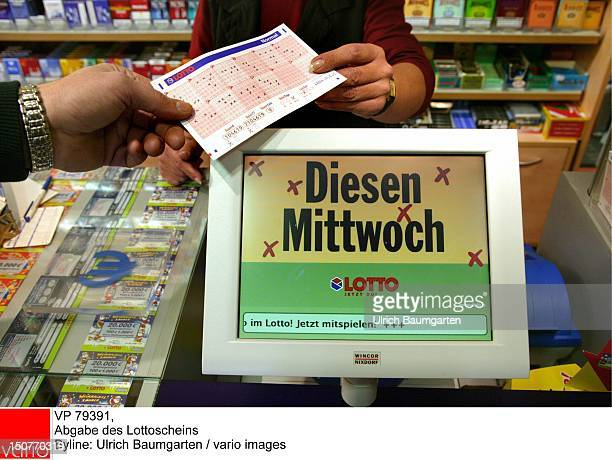 Customer giving his lottery coupon to the lottery counter