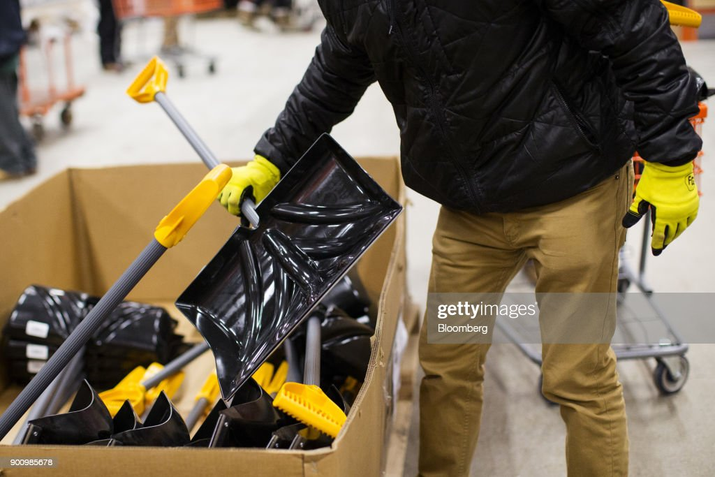 A customer grabs a snow shovel at a Home Depot Inc. store in Boston, Massachusetts, U.S., on Wednesday, Jan. 3, 2018. The worst winter storm of the season has already knocked out power and canceled more than 1,600 flights. Next it threatens to bring more snow, ice and cold from Florida to Nova Scotia, including New York and Boston. Photographer: Adam Glanzman/Bloomberg via Getty Images