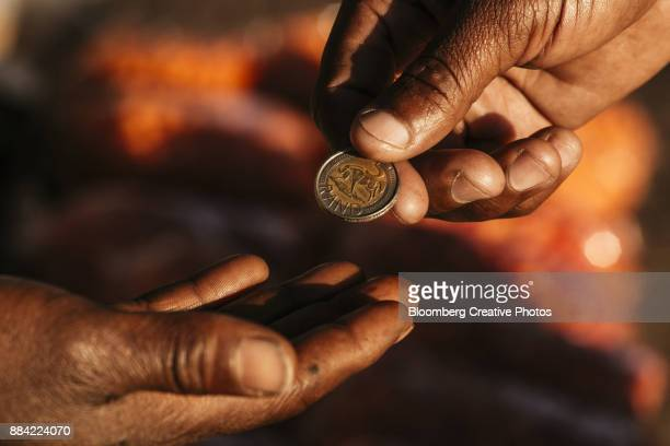 a customer hands over a five rand coin - south african currency stock pictures, royalty-free photos & images