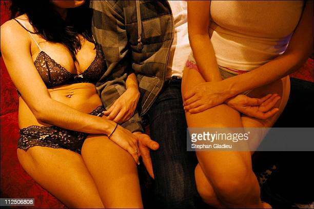 A customer hangs out with two working girls in the parlor of the Moonlite Bunny Ranch a legal brothel owned by Dennis Hof in Lyon County one of the...