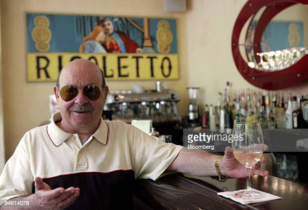 Customer has a glass of wine inside Rigoletto restaurant in Dortmund, Germany, Thursday, June 8, 2006. Dortmund is a city without pretensions. Which...