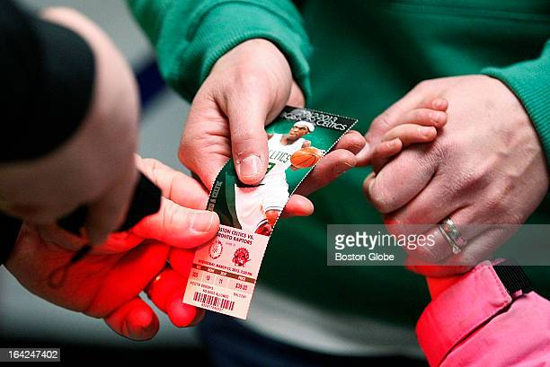 A customer has her paper ticket scanned before the game start of a Celtics game at the TD Garden in Boston Mass on Wednesday March 13 2013 The...