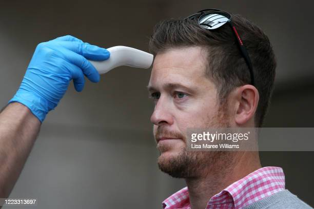 Customer has his temperature tested prior to entering the Apple Store at Bondi Junction on May 07, 2020 in Sydney, Australia. Apple stores across...