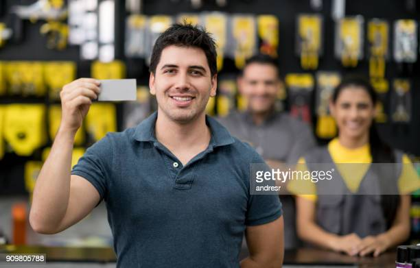 Customer holding a business card at a hardware store