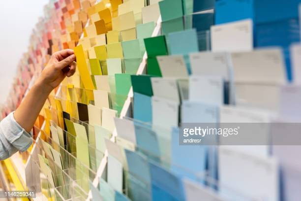 customer holding a color sample at a home improvement store - artist's palette stock pictures, royalty-free photos & images