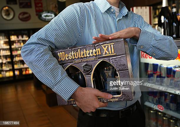 Customer holds a six-pack of Westvleteren 12 at Ales Unlimited on December 12, 2012 in San Francisco, California. Beer connoisseurs across the United...