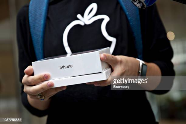 A customer holds an Apple Inc iPhone XS Max box during a sales launch at a store in Chicago Illinois US on Friday Sept 21 2018 The iPhone XS is up to...