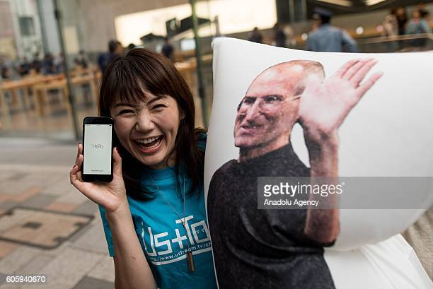 A customer holds an iPhone at Apple Store in Omotesando Avenue in Tokyo Japan on September 16 2016 Apple has released for sale its new iPhone models...