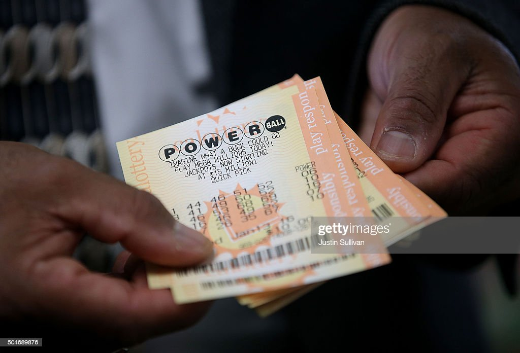 A customer holds Powerball tickets that he purchased at Kavanagh Liquors on January 12, 2015 in San Lorenzo, California. Dozens of people lined up outside of Kavanagh Liquors, a store that has had several multi-million dollar winners, to -purchase Powerball tickets in hopes of winning the estimated record-breaking $1.5 billion dollar jackpot.