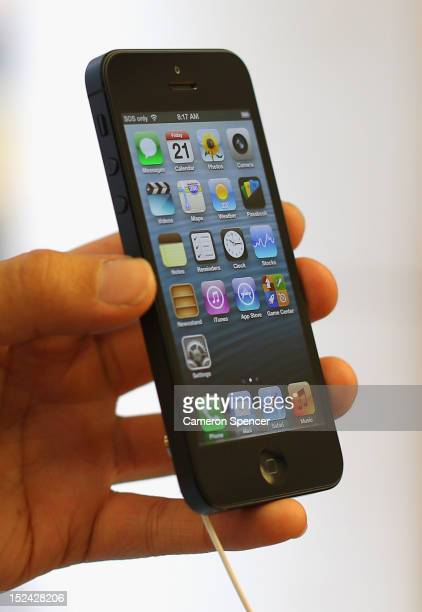 A customer holds the iPhone 5 smartphone at the Apple flagship store on George street on September 21 2012 in Sydney Australia Australian Apple...