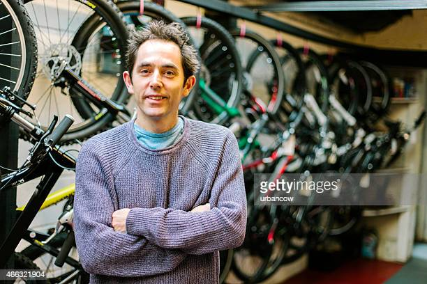 Customer in a bicycle shop, smiling and looking at camera