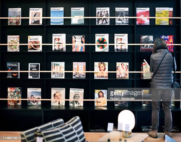 A customer in a Santa Fe New Mexico store looks at a selection of magazines for sale