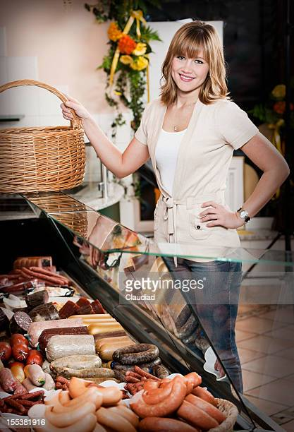 Customer in butchers shop
