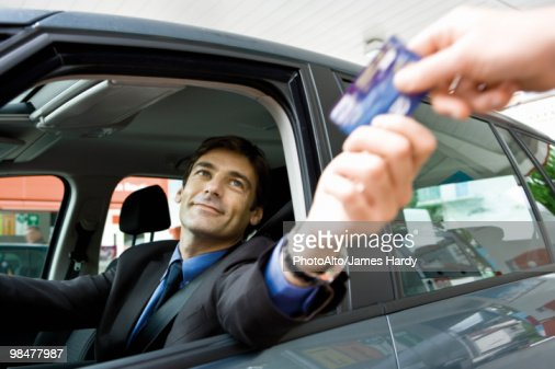 customer in drivethru handing credit card to checkout window clerk stock photo getty images. Black Bedroom Furniture Sets. Home Design Ideas