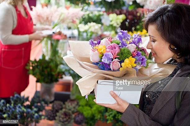 Customer in Florist Shop Carrying an Arrangement