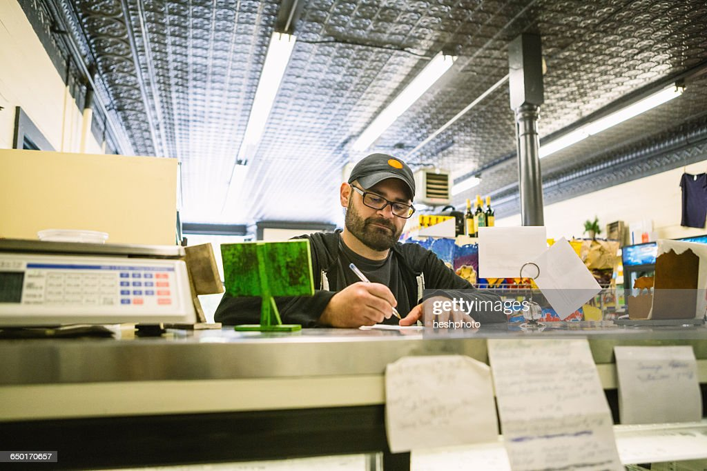 Customer in general store, Hague, USA : Stock Photo