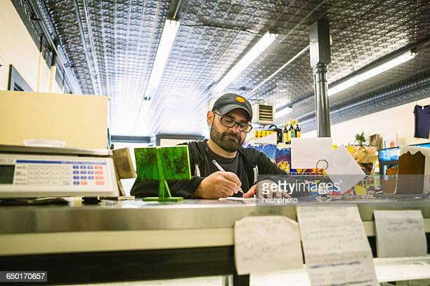 customer in general store, hague, usa - heshphoto stock pictures, royalty-free photos & images