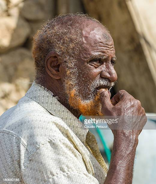 CONTENT] A customer in Hadibu market with his henne stained beard