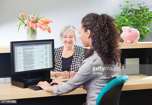 customer in retail banking counter window with bank teller - cashier stock pictures, royalty-free photos & images
