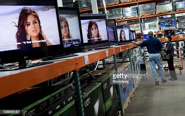 A customer inquires about televisions while shopping at a Costco Wholesale Corp store in Arlington Virginia US on Tuesday Nov 9 2010 Inventories at...