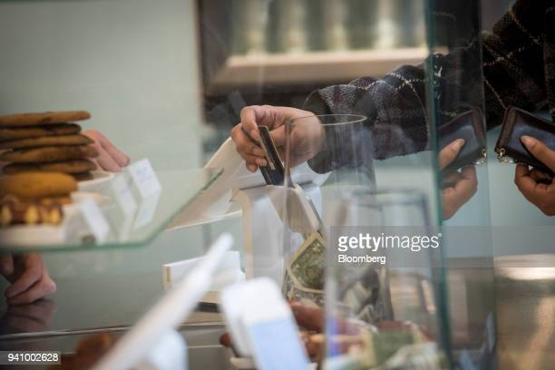 A customer inserts a credit card into Square Inc device while making a payment in San Francisco California US on Tuesday March 27 2018 The mobile...