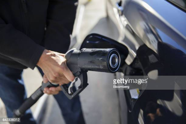 A customer inserts a hydrogen H70 fuel pump nozzle to a Toyota Motor Co Mirai hydrogen fuel cell vehicle at the UC Irvine Hydrogen Fueling Station...