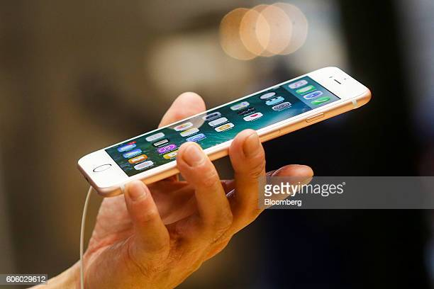 A customer inspects a new iPhone 7 plus smartphone inside the Apple Inc Covent Garden store in London UK on Friday Sept 16 2016 Consumers buying...