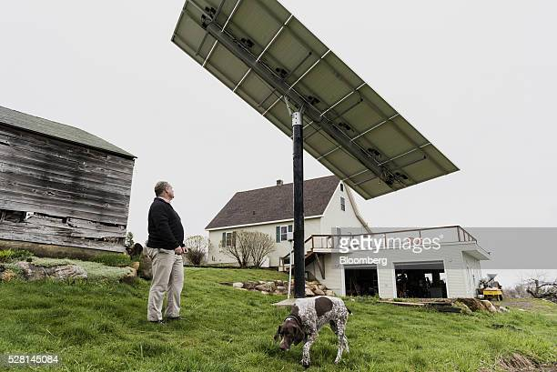 A customer inspects a solar panel that is linked to a Tesla Motors Inc Powerwall at a home in Monkton Vermont US on Monday May 2 2016 A year after...