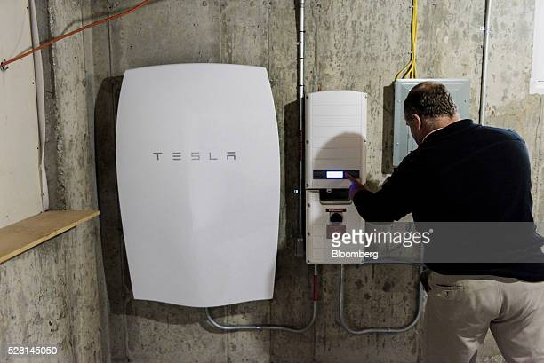 A customer inspects a Tesla Motors Inc Powerwall unit inside a home in Monkton Vermont US on Monday May 2 2016 A year after Elon Musk unveiled the...